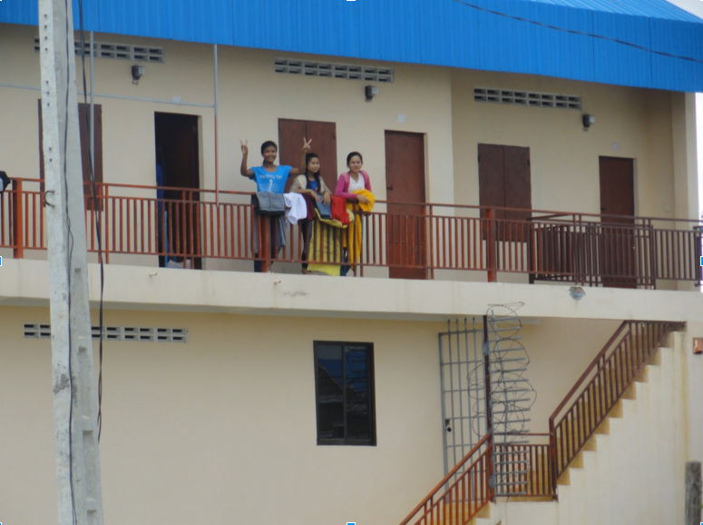 Workers outside their rooms