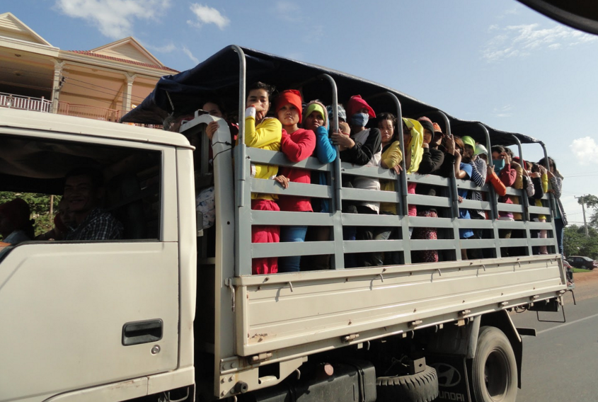 Factory workers commute in standing room only.